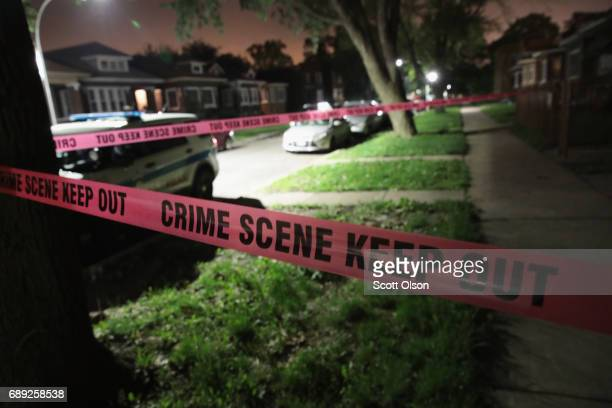 Crime scene tape is stretched around the front of a home where a man was shot on May 28, 2017 in Chicago, Illinois. Chicago police have added more...