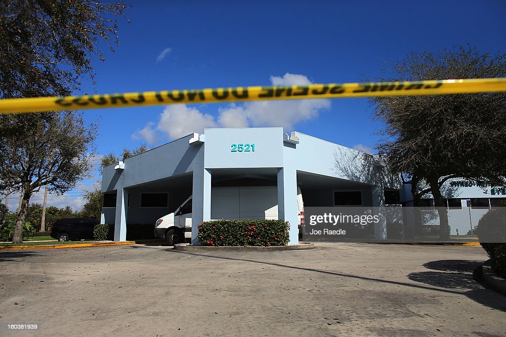Crime scene tape marks off a building as FBI agents and other law enforcement officials investigate at the medical-office complex of Dr. Salomon Melgen who has possible ties to U.S. Sen. Bob Menendez (D-NJ) on January 30, 2013 in West Palm Beach, Florida. The agents arrived last night at the medical-office complex and started hauling away potential evidence in several vans.