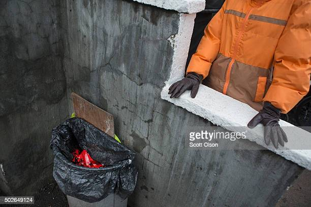 Crime scene tape remains in the trash can outside the front door a day after Bettie Jones and Quintonio LeGrier were killed on December 27 2015 in...