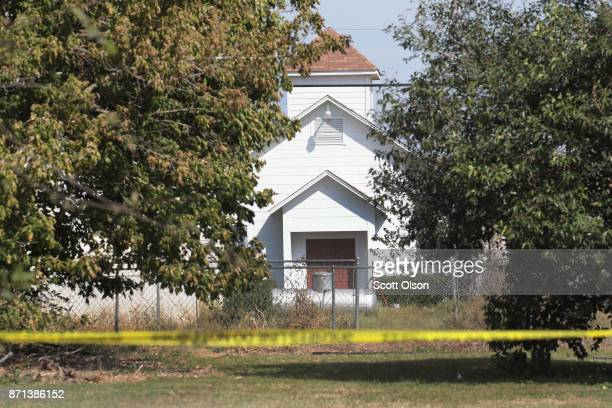 Crime scene tape remains stretched along a road near the First Baptist Church of Sutherland Springs on November 7 2017 in Sutherland Springs Texas On...