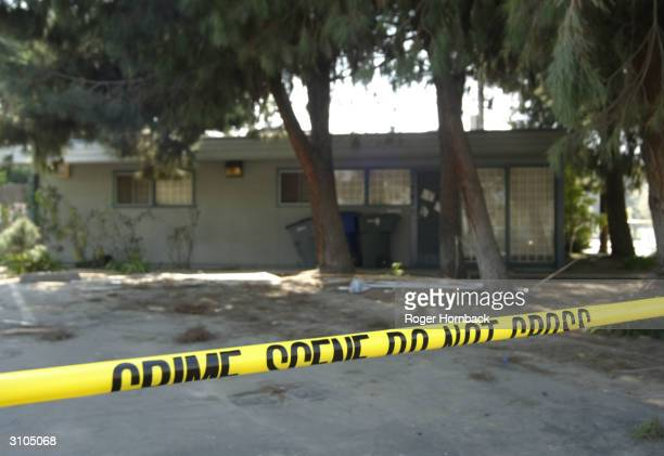 Crime scene tape stretches across the front of the house where accused killer Marcus Wesson lived March 17 2004 in Fresno California Wesson is...
