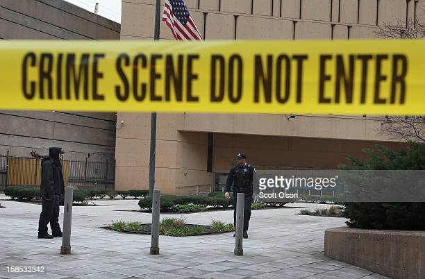 Crime scene tape surrounds the federal Metropolitan Correctional Center in the Loop after two convicted bank robbers escaped on December 18 2012 in...