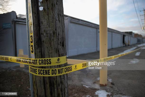 Crime scene tape surrounds the Shetland Business Park following yesterday's shooting at the Henry Pratt Company on February 16 2019 in Aurora...