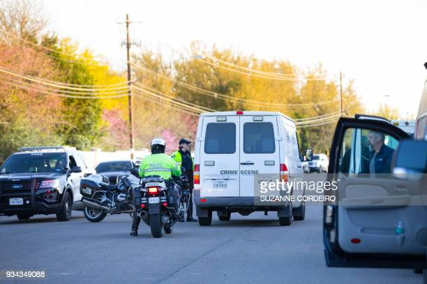 Crime Scene vehicles and local law enforcement work the scene of a bombing on March 19 near the 4800 block of Dawn Song Drive in Austin Texas Police...