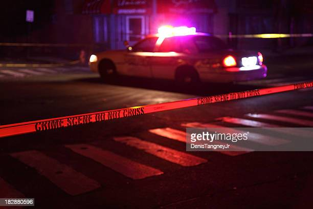 crime scene with police car - cordon tape stock pictures, royalty-free photos & images