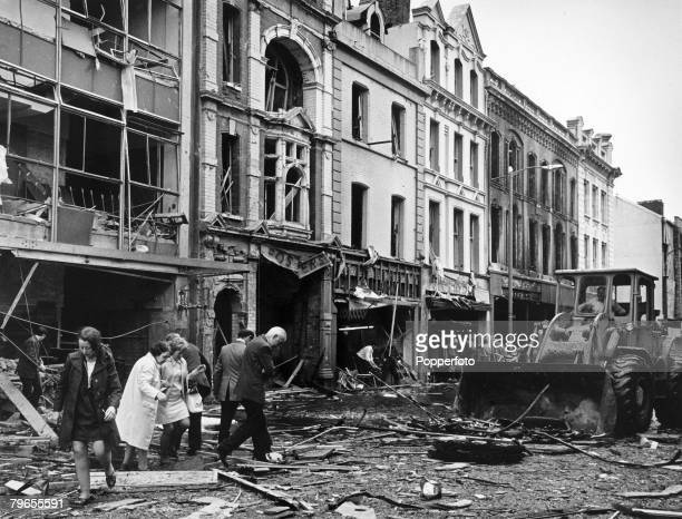 22nd July 1972 Londonderry Devastation caused by a 250 lb IRA bomb that wrecked this street as people walk through the rubble as the clearup begins