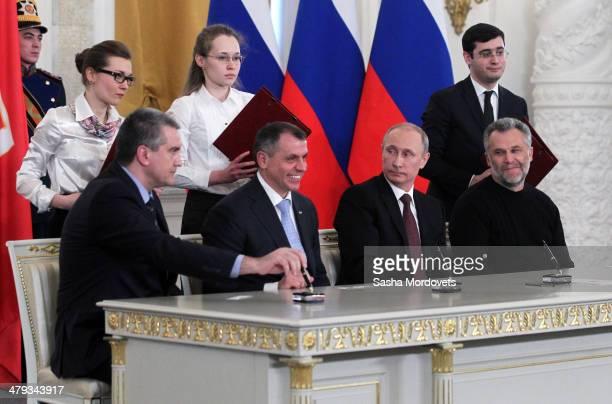 Crimea Prime Minister Sergei Aksyonov, Chairman of the Crimea State Council Vladimir Konstantinov, Russian President Vladimir Putin and Mayor of...