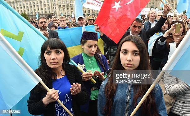 Crimean Tatars participate in a memorial ceremony on the Independence square in Kiev on May 18 2016 in commemoration of the 72nd anniversary of the...