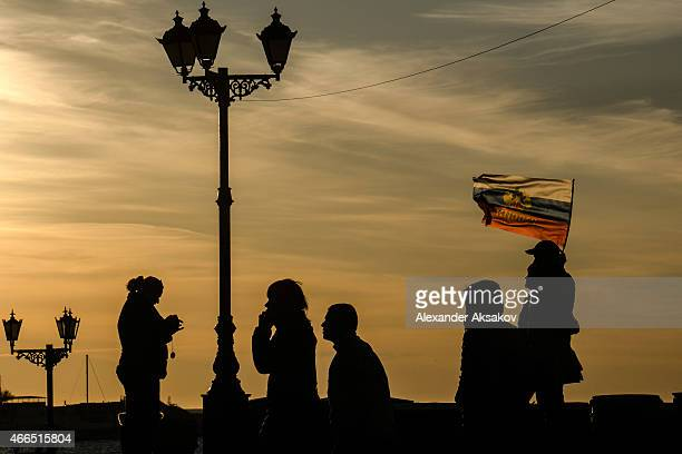 Crimeans celebrate the first anniversary of the referendum at sunset on March 16 2014 in Sevastopol Crimea Today marks the first anniversary of the...