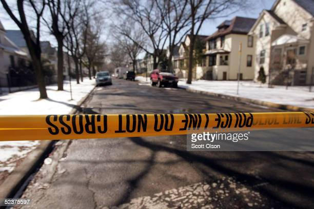 Crimescene tape stops all but the residents at the end of the block where murder suspect Bart Ross lived on the city's northwest side March 11 2005...