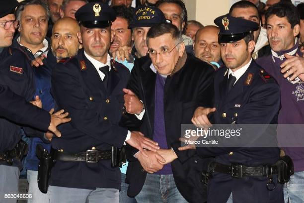 Criminal boss Michele Zagaria, caught in Casapesenna by the Italian police, while being escorted to jail by Caserta police men.