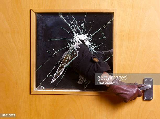 criminal breaking an entering home office - burglary stock pictures, royalty-free photos & images
