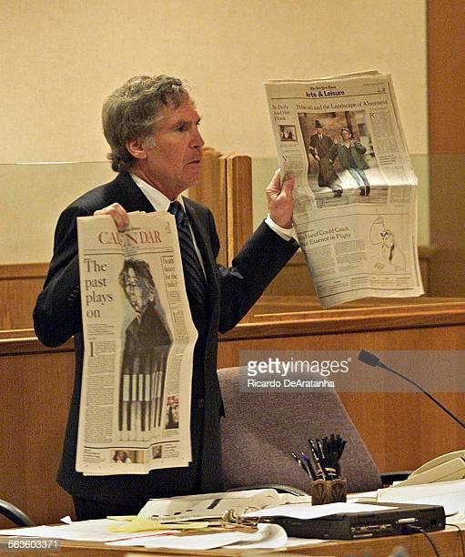 Criminal Defense Attorney Roger Diamond holding newspaper articles about film director Roman Polanski's statutory rape case calling him an...