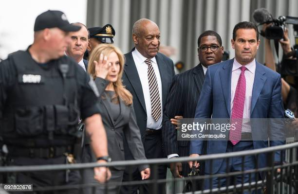 Criminal defense attorneys Brian McMonagle, Angela Agrusa and actor Bill Cosby are seen leaving the first day of Bill Cosby court trial at Montgomery...