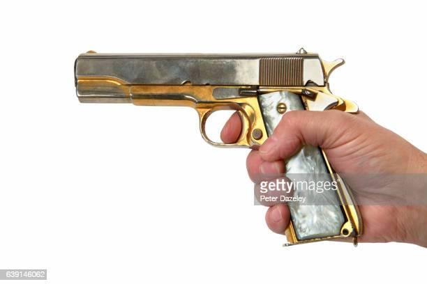 Criminal hand firing handgun