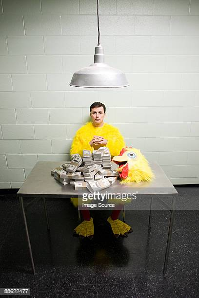 Criminal in chicken suit with money
