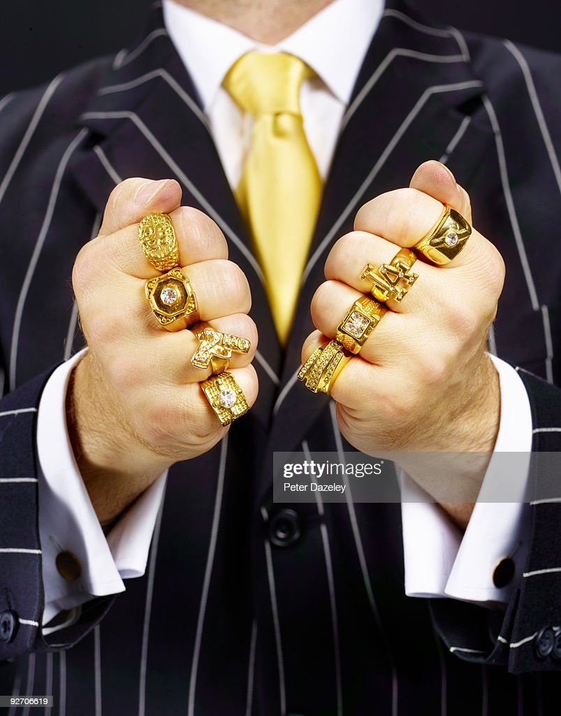 Criminal in suit wearing gold rings. : Stock Photo