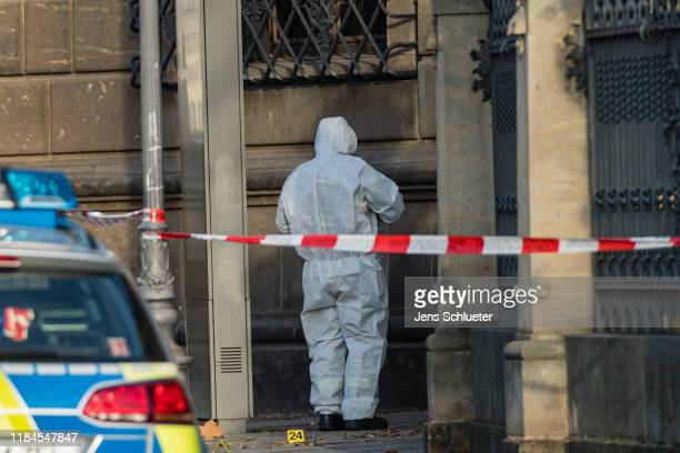 Criminal police investigate the surrounding area outside the Residenzschloss palace that houses the Gruenes Gewoelbe collection of treasures on...