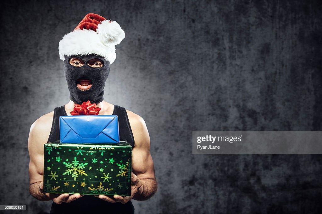 Criminal with Christmas Presents : Stock Photo