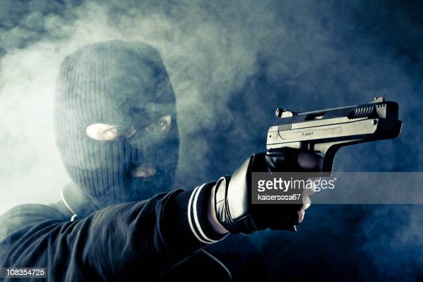 criminal with gun - balaclava stock pictures, royalty-free photos & images