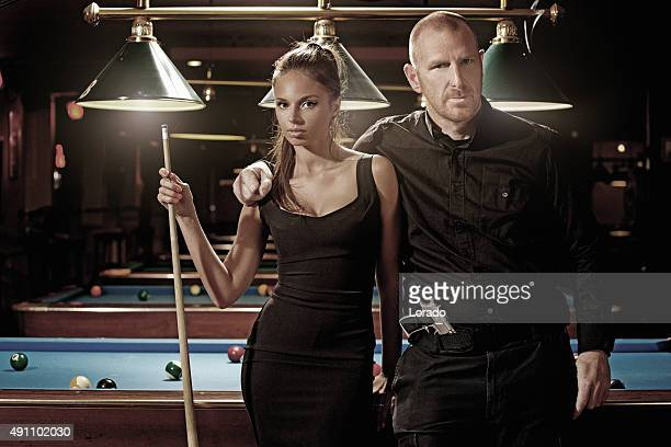 criminal with his girlfriend at pool hall