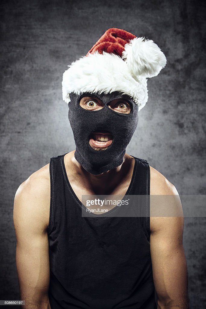 Criminal with Santa Claus Hat : Stock Photo