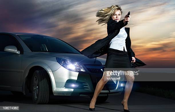 Criminal Woman against a Car