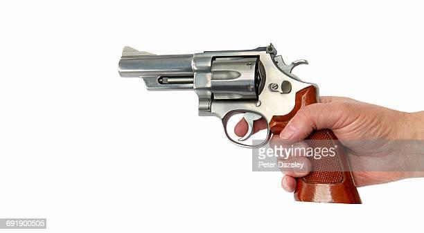criminal's hand firing magnum 44 - gun stock pictures, royalty-free photos & images