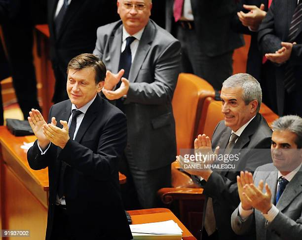 Crin Antonescu leader of National Liberal Party opposition party and Presidential candidate of PNL applauds together with party members after hearing...