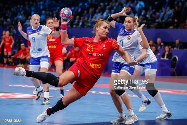 CrinaElena Pintea of Romania is shoots the ball on target against Daria Dmitrieva of Russia during the EHF Euro semifinal match between Russia and...