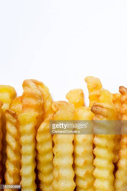 Crinkle Cut Oven Chips or French Fries White Background