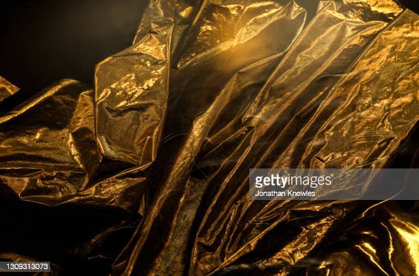 crinkled gold fabric - gold coloured stock pictures, royalty-free photos & images