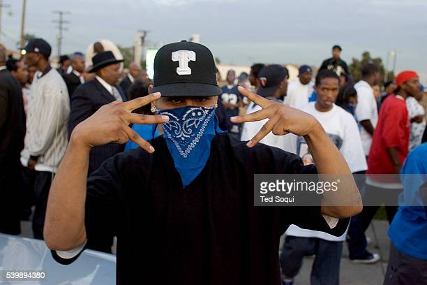 Crip gang member at the funeral services for Stanley 'Tookie' Williams at Bethel AME Church in South Central Los Angeles Approx 2000 people attended...