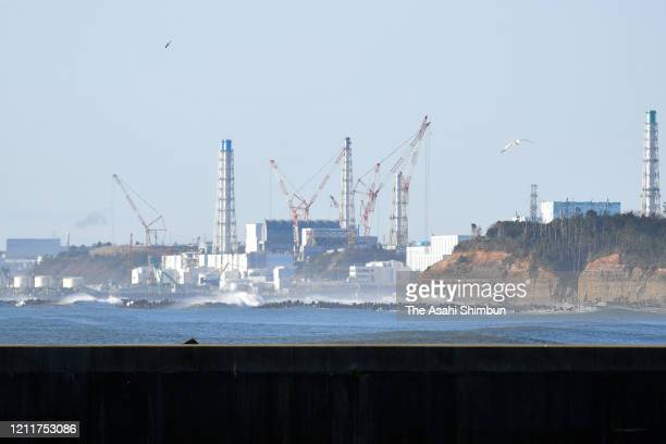 Crippled Fukushima Daiichi Nuclear Power Plant is seen on the 9th anniversary of the Great East Japan Earthquake on March 11, 2020 in Namie,...