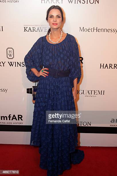 Cris Barros attends the 5th Annual amfAR Inspiration Gala at the home of Dinho Diniz on April 10 2015 in Sao Paulo Brazil