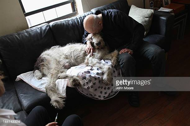 Cris Cristofaro gives a final hug to his dog Dino as veterinarian Wendy McCulloch prepares to perform an inhome pet euthanasia on May 9 2012 in New...