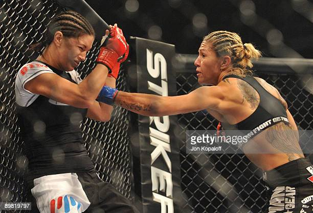 Cris Cyborg battles Gina Carano during their Middleweight Championship fight at Stikeforce: Carano vs. Cyborg on August 15, 2009 in San Jose,...