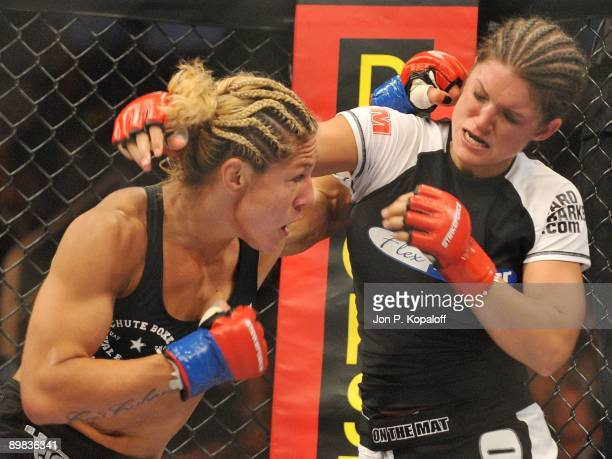 Cris Cyborg battles Gina Carano during their Middleweight Championship fight at Strikeforce: Carano vs. Cyborg on August 15, 2009 in San Jose,...