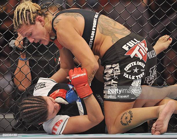 Cris Cyborg battles Gina Carano during their Middleweight Championship fight at Strikeforce Carano vs Cyborg on August 15 2009 in San Jose California