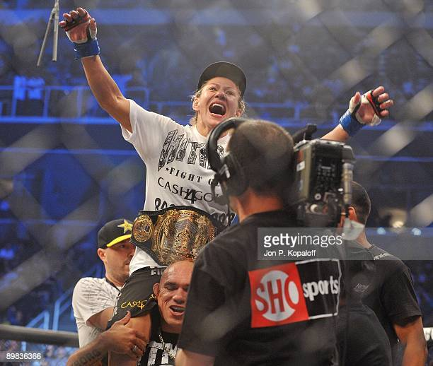 Cris Cyborg celebrates her first round knockout victory over Gina Carano during their Middleweight Championship fight at Strikeforce: Carano vs....