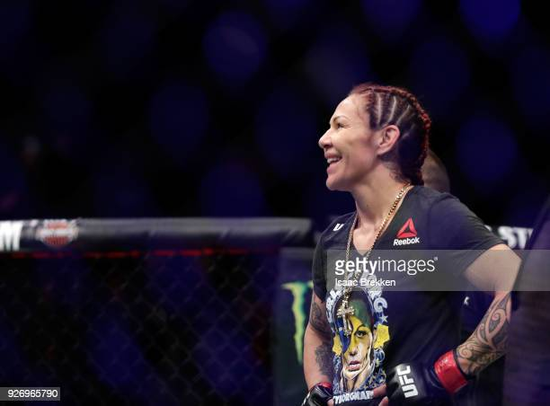 Cris Cyborg celebrates her victory over Yana Kunitskaya following their women's featherweight title bout during UFC 222 at TMobile Arena on March 3...