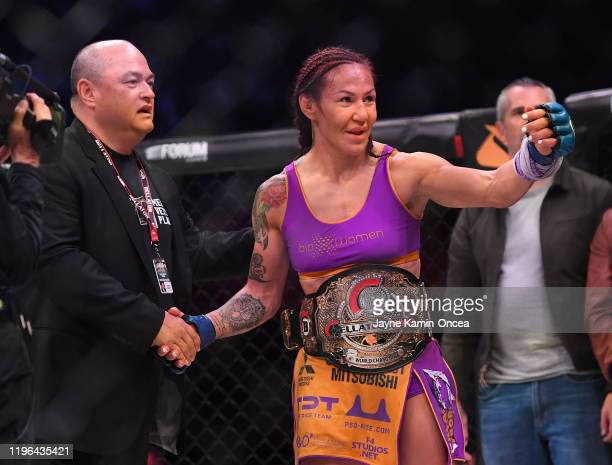 Cris Cyborg is congratulated by Bellator president Scott Coker after defeating Julia Budd in their featherweight world title fight at The Forum on...