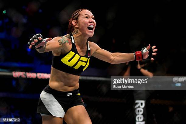Cris 'Cyborg' Justino of Brazil celebrates after defeating Leslie Smith of the United States in their catchweight bout during the UFC 198 at Arena da...