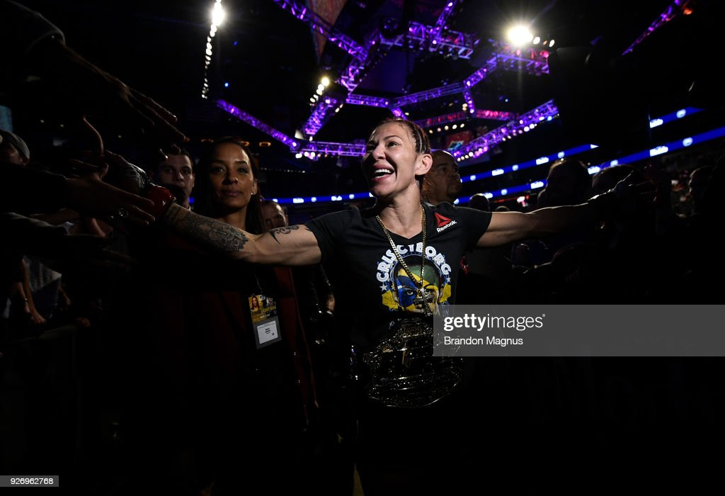 Cris Cyborg of Brazil celebrates after her TKO victory over Yana Kunitskaya of Russia in their women's featherweight bout during the UFC 222 event inside T-Mobile Arena on March 3, 2018 in Las Vegas, Nevada.