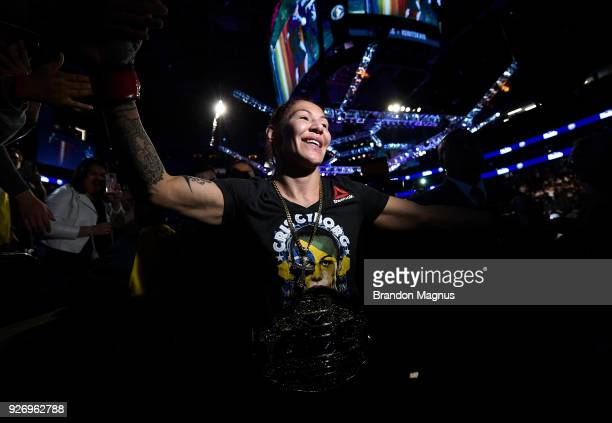 Cris Cyborg of Brazil celebrates after her TKO victory over Yana Kunitskaya of Russia in their women's featherweight bout during the UFC 222 event...