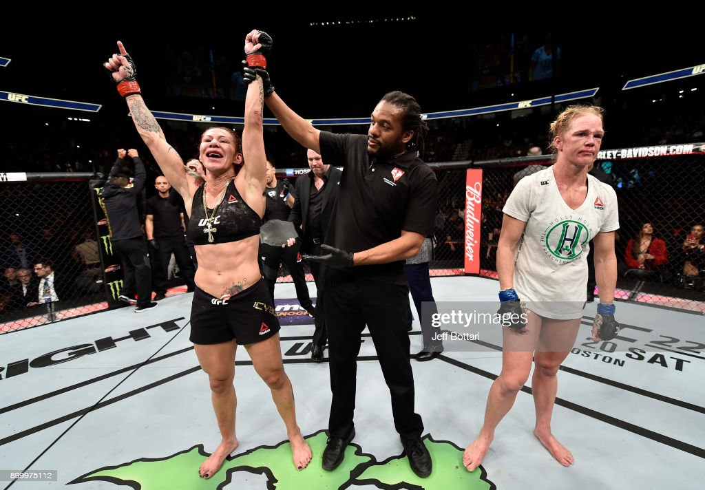 Cris Cyborg of Brazil celebrates after her unanimous-decision victory over Holly Holm in their women's featherweight bout during the UFC 219 event inside T-Mobile Arena on December 30, 2017 in Las Vegas, Nevada.