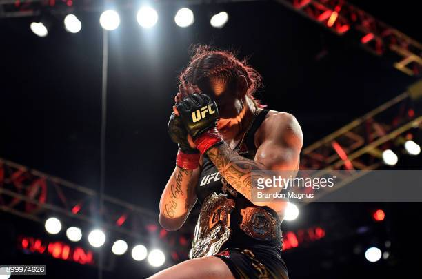 Cris Cyborg of Brazil celebrates after her victory over Holly Holm in their women's featherweight bout during the UFC 219 event inside TMobile Arena...