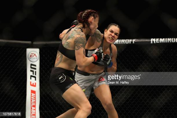 Cris Cyborg of Brazil is punched by Amanda Nunes during a Women's Feather weight bout during the UFC 232 event inside The Forum on December 29 2018...