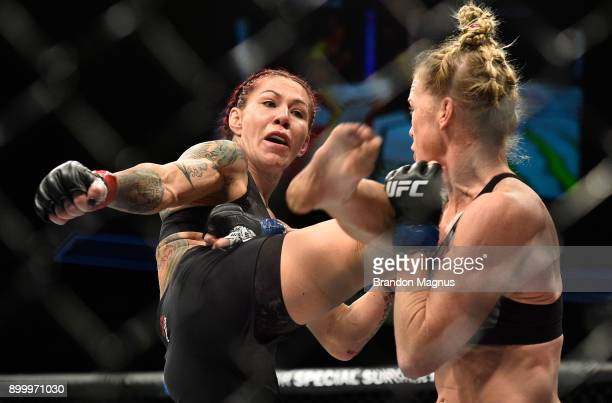 Cris Cyborg of Brazil kicks Holly Holm in their women's featherweight bout during the UFC 219 event inside TMobile Arena on December 30 2017 in Las...