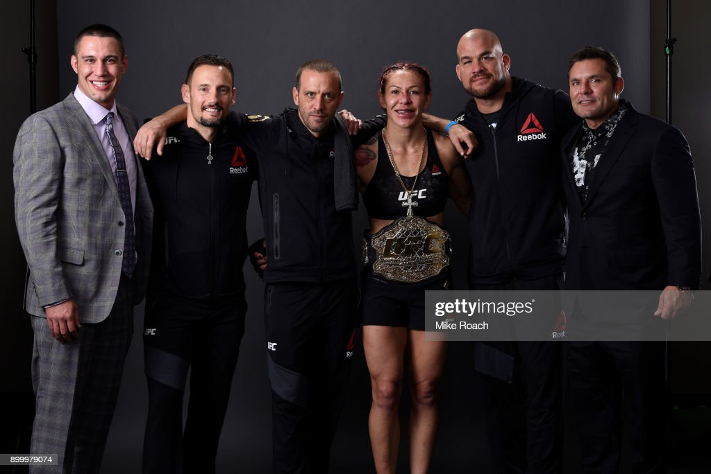 Cris Cyborg of Brazil poses for a portrait backstage with her team after her victory over Holly Holm during the UFC 219 event inside T-Mobile Arena on December 30, 2017 in Las Vegas, Nevada.